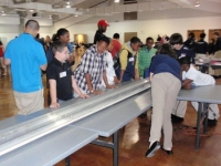 Students making last minute adjustments before the Magnetic Levitation races