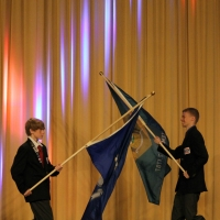 DETSA President, Davey McGinnis carrying the flag of the state of Delaware.